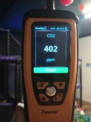 CO2 monitor showing health levels indoors